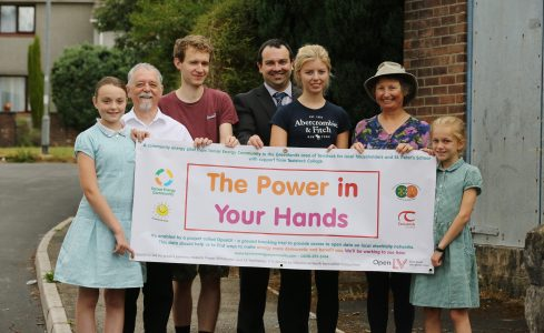 The Power in Your Hands team with banner